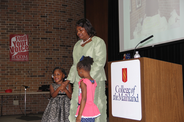 Tillie Henson speaks at the COM 2017 Juneteenth celebration with her granddaughters